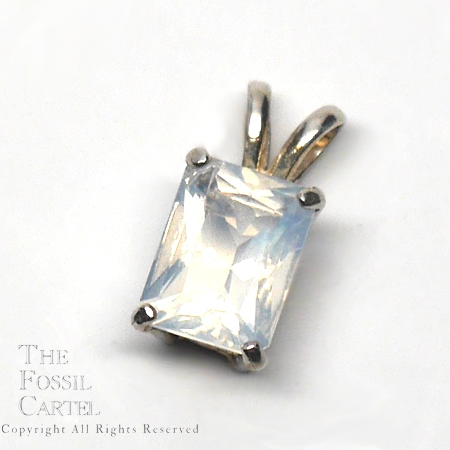 Faceted Oregon Opal rectangle pendant in sterling silver against a grey background