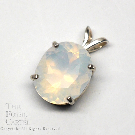 Faceted Oregon Opal oval pendant in sterling silver against a grey background
