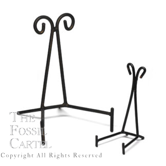 A pair of black wrought iron triangle stands against a white background