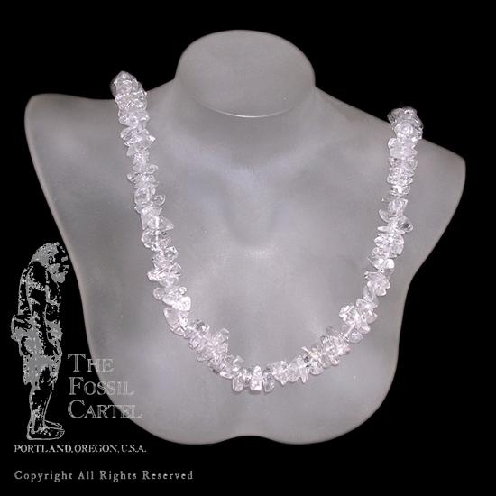 A clear quartz tumbled chip necklace against a black background