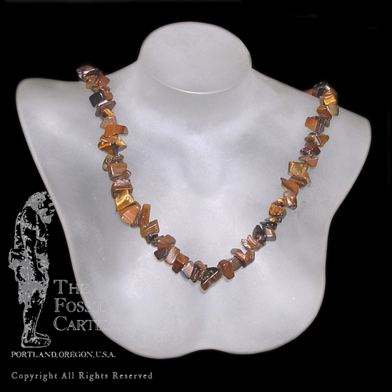 A tumbled tiger's eye chip necklace against a black background