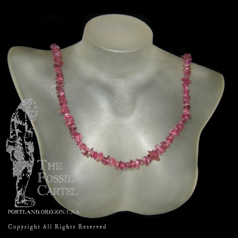 A pink tourmaline chip necklace against a black background