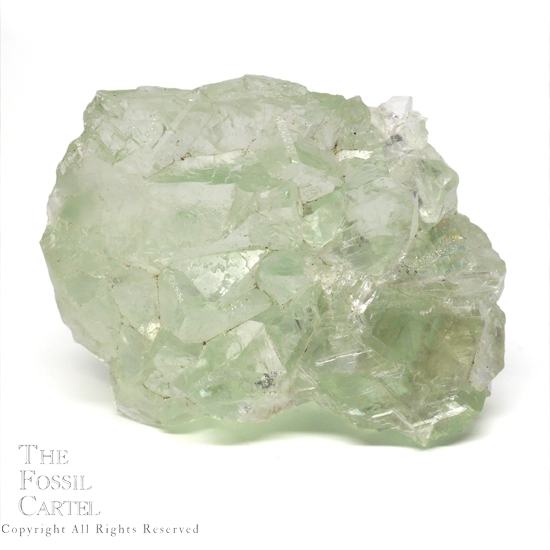 A light green translucent fluorite cluster from China against a white background