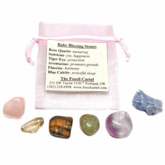 A baby blessing healing pouch featuring tumbled rose quartz, sunstone, tiger's eye, aventurine, fluorite, and blue calcite