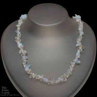 A necklace made of opalite chips against a black background