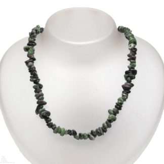 A necklace made of ruby in zoisite chips against a white background