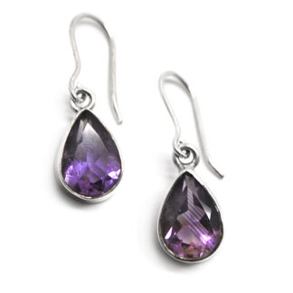 A pair of teardrop faceted amethyst earrings in sterling silver against a white background