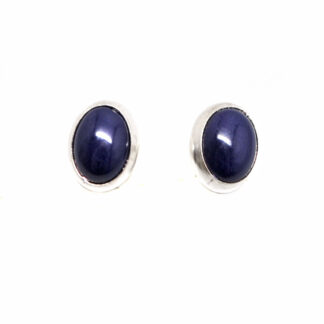 A pair of lapis lazuli sterling silver stud earrings against a white background