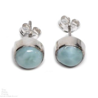 A pair of round sterling silver larimar stud earrings against a white background