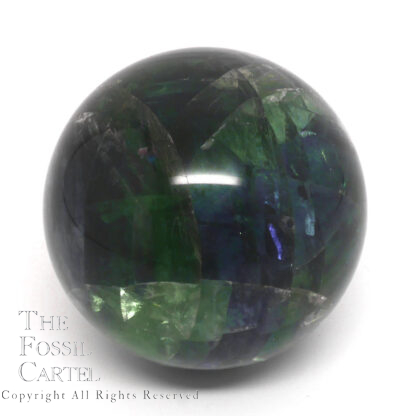 A rainbow fluorite sphere against a white background
