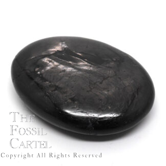 A polished hypersthene palm stone against a white background