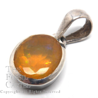 A translucent, faceted, Ethiopian opal oval set in a sterling silver pendant against a white background