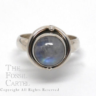 A sterling silver ring set with a round rainbow moonstone against a white background