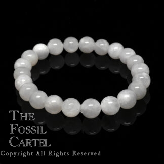 A beaded bracelet with colorless moonstone against a black background