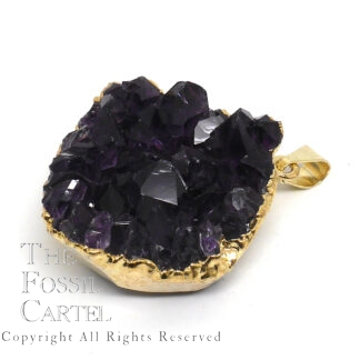 A small cluster of dark purple amethyst crystals with gold-colored electroplating affixed to a bail which it hangs from to be worn as a pendant