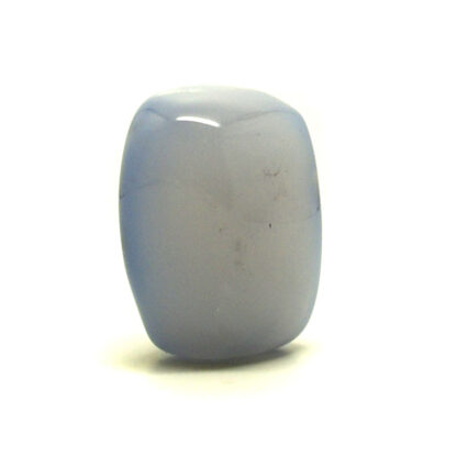 A polished pale blue chalcedony palm stone against a white background