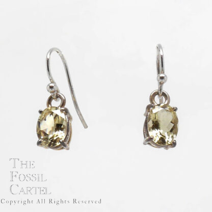 Faceted oval cut yellow heliodor sterling silver dangle earrings against a grey background