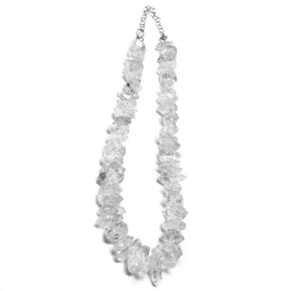 A drilled herkimer diamond quartz necklace against a white background