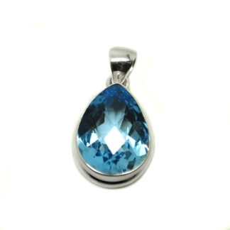 A teardrop faceted blue topaz gemstone set in a sterling silver pendant against a white background