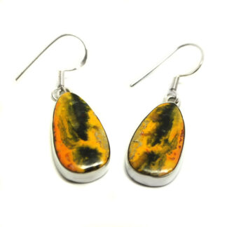 A pair of teardrop bumblebee jasper cabochons set in sterling silver earrings against a white background