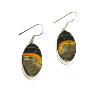 A pair of oval bumblebee jasper cabochons set in sterling silver earrings against a white background