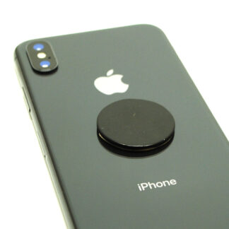 A circular shungite phone tile sticker on a grey smart phone against a white background
