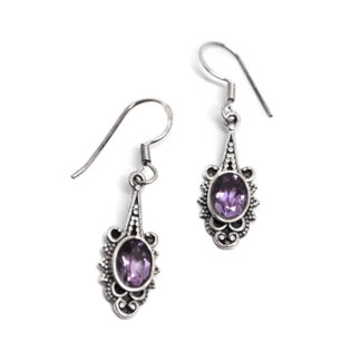 A pair of ornate sterling silver amethyst dangle earrings against a white background