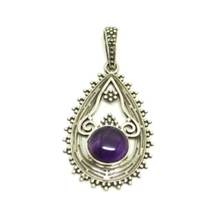 A round amethyst cabochon set in an intricate sterling silver pendant against a white background