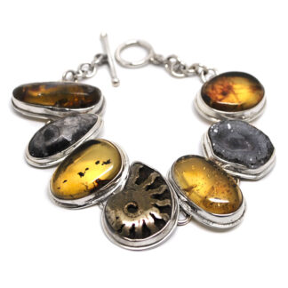 A sterling silver bracelet featuring a pyritized ammonite fossil, orthoceras fossil, druzy chalcedony, and amber against a white background