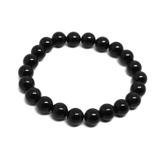 A black tourmaline beaded bracelet against a white background