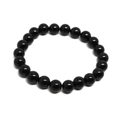 A black tourmaline beaded bracelet against a white background