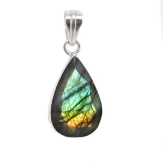 A faceted labradorite sterling silver pendant against a white background