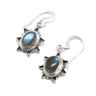 A pair of ornate sterling silver earrings with oval labradorite cabochons against a white background