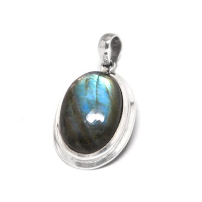 An oval labradorite sterling silver pendant against a white background