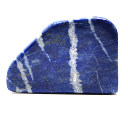 A freeform lapis lazuli carving against a white background