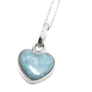 A heart shaped larimar necklace in sterling silver against a white background