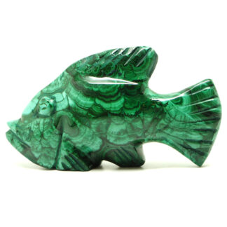 A piece of malachite carved and polished into a fish figurine against a white background
