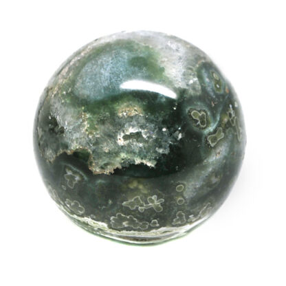 A deep green and yellow ocean jasper sphere against a white background