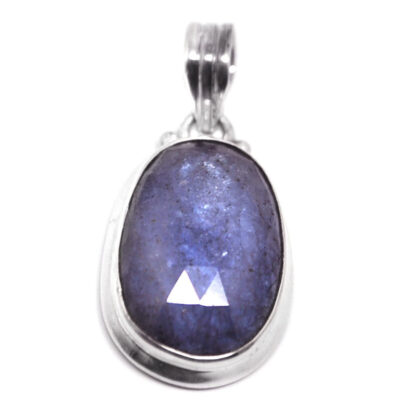 A sterling silver faceted tanzanite pendant against a white background