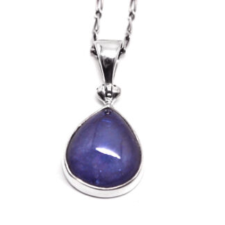 A sterling silver tanzanite pendant against a white background