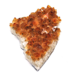 A citrine crystal cluster against a white background