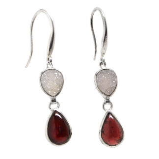 A pair of sterling silver dangle earrings featuring druzy quartz and red garnet gemstones against a white background