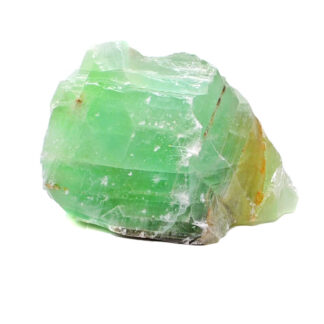 A rough chunk of emerald green calcite against a white background