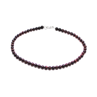 A beaded garnet necklace with a sterling silver S hook clasp against a white background
