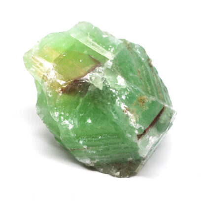 A piece of rough emerald calcite against a white background