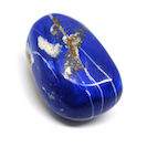 A polished lapis lazuli freeform specimen against a white background