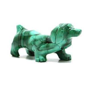 A green malachite dog carving against a white background