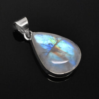 A teardrop shaped rainbow moonstone sterling silver necklace against a black background