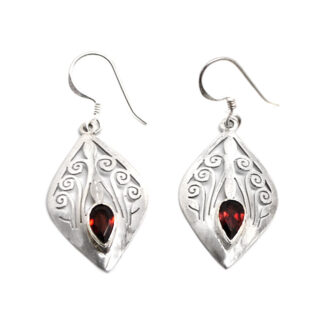 A pair of intricately designed sterling silver diamond-shaped earrings with faceted garnet gemstones against a white background