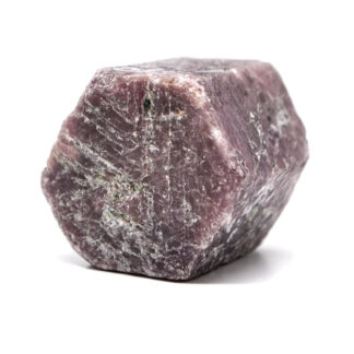 A rough ruby crystal against a white background